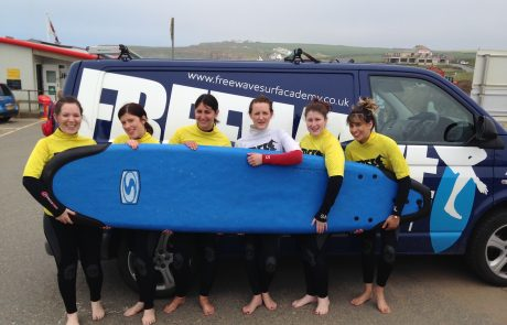 Hen Party holding Surfboard